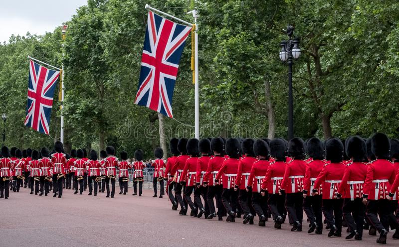 Soldiers marching down The Mall in London during the Trooping the Colour military ceremony, London. London UK. Soldiers with rifles and bayonets marching down royalty free stock photo