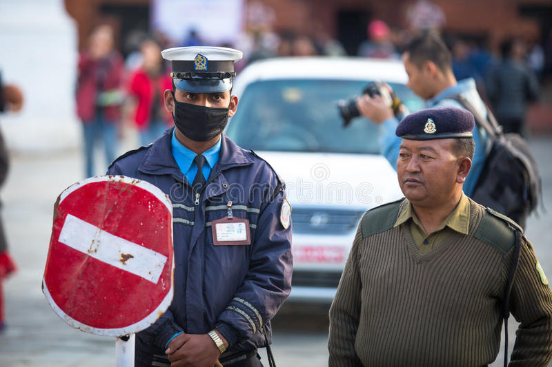 Soldiers during protest within a campaign to end violence against women (VAW) Held annually since 1991, 16 days from Nov 25. KATHMANDU, NEPAL - NOV 29, 2013 stock images