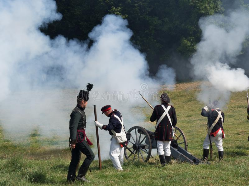 Waterloo, Belgium - June 18 2017: Scenes from the reenactment of. Soldiers reload and fire a cannon during the re-enactment of the battle of Waterloo stock photo