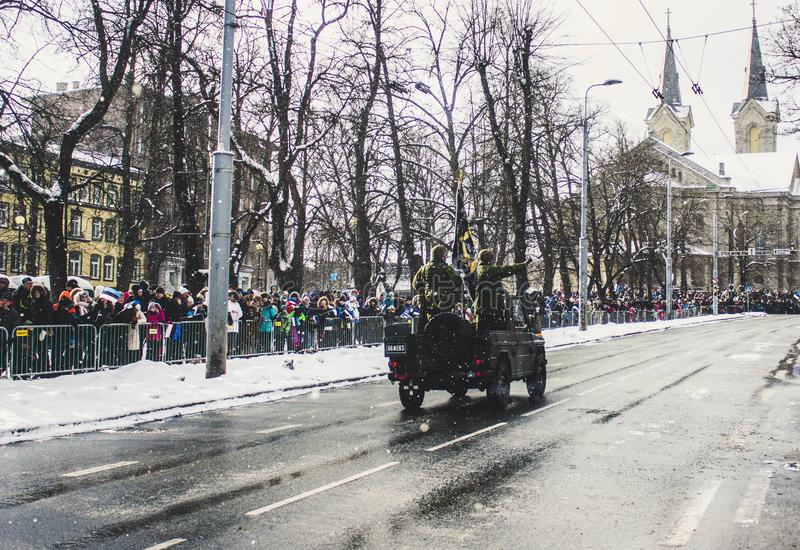 Soldiers Riding a Vehicle during a Parade royalty free stock image