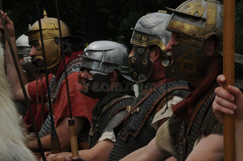 Roman soldiers stand at attention in a medieval reenactment royalty free stock image