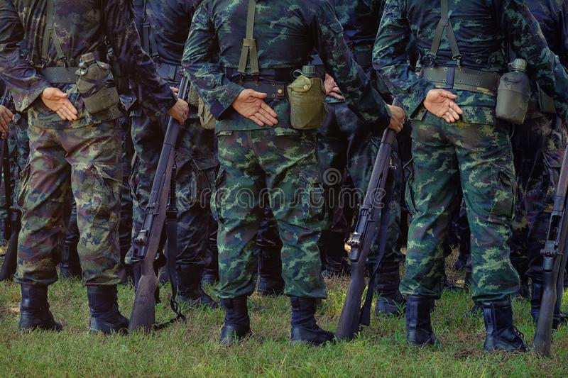 Soldiers stand in row. Gun in hand. Army, Military Boots lines o stock photos