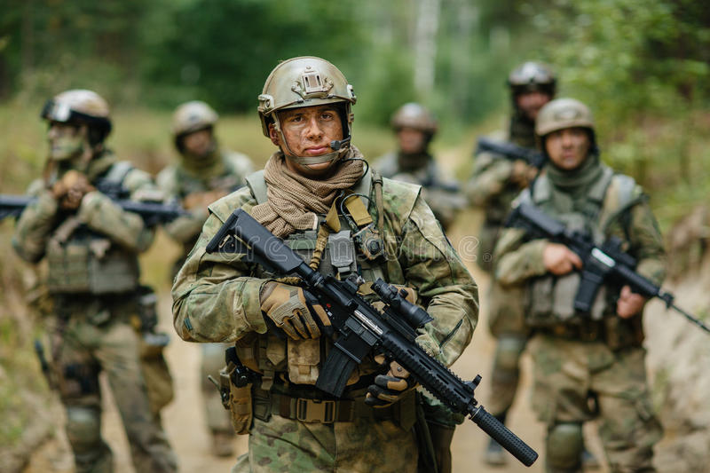 Soldiers standing with the team and is looking forward royalty free stock photography