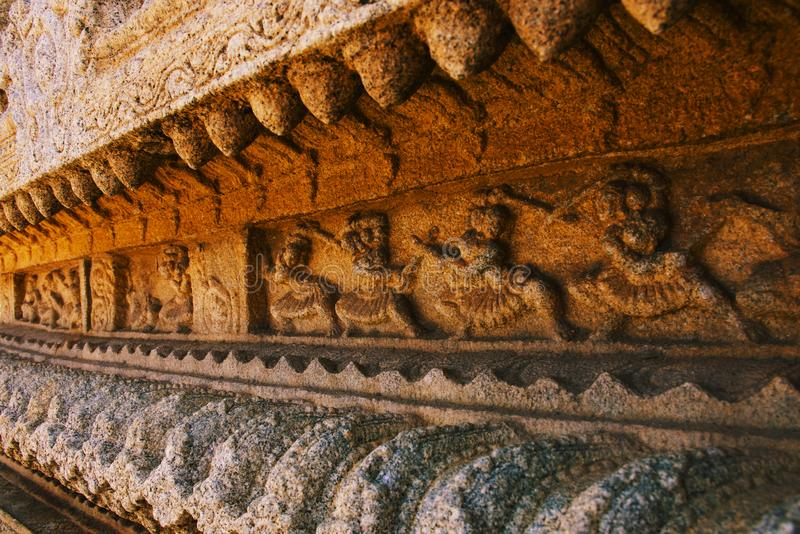 Soldiers training with swords sculpture at the Vittala Temple, Hampi, Karnataka, India.  royalty free stock images
