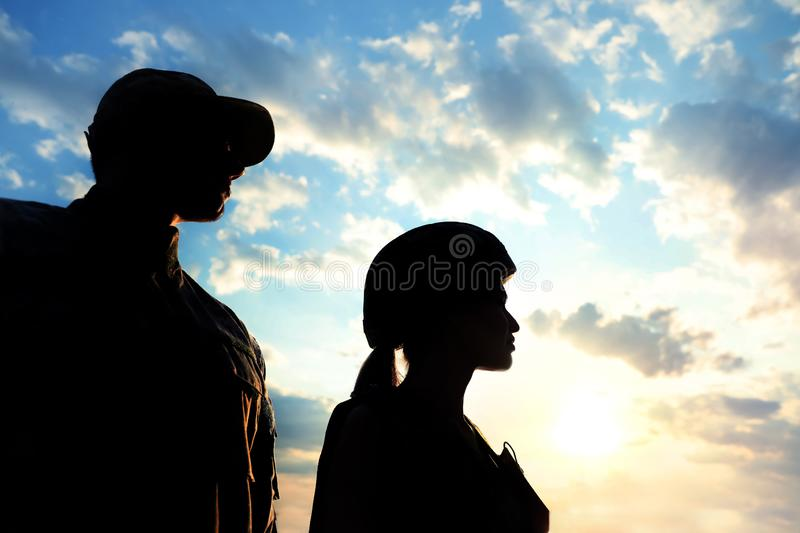 Soldiers in uniform patrolling. Military service stock photos