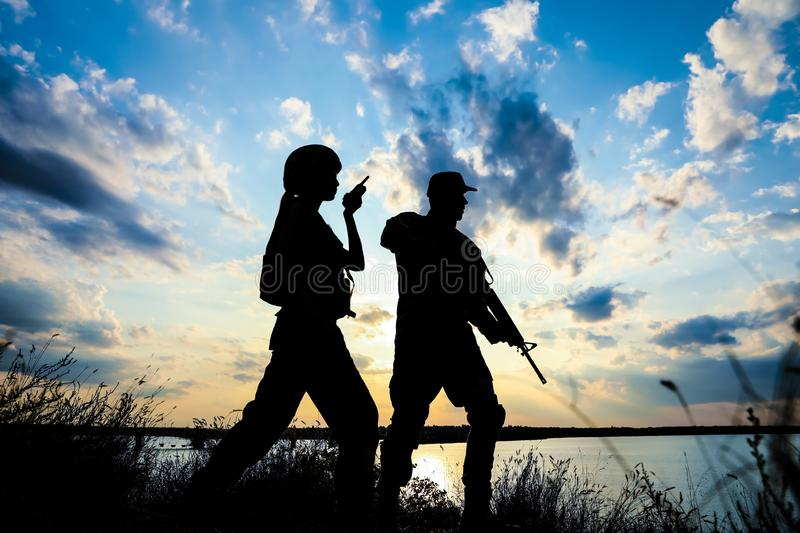 Soldiers in uniform patrolling. Military service stock image