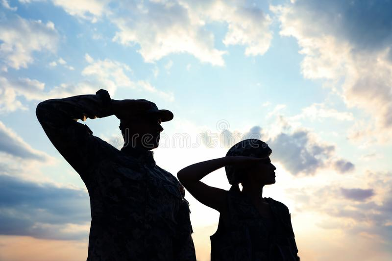Soldiers in uniform saluting. Military service royalty free stock photo