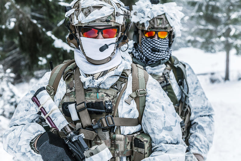Soldiers in winter forest royalty free stock photos