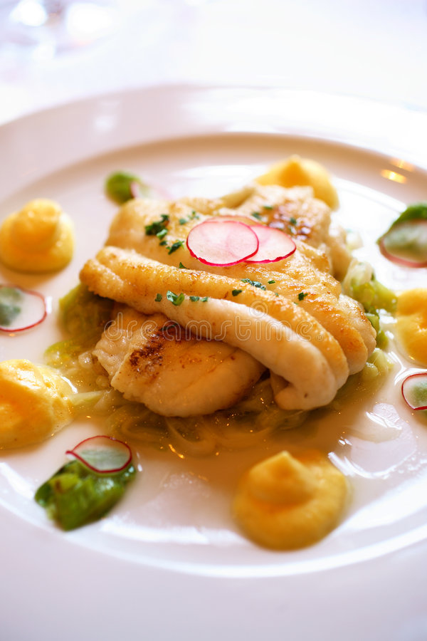 Sole fillet with asparagus and radish stock image