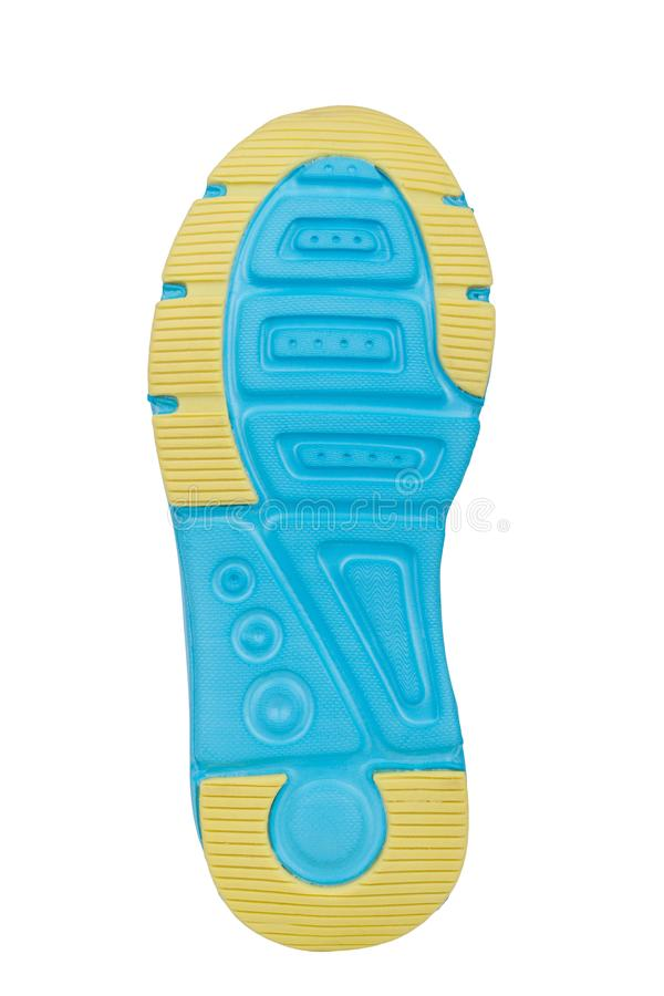 Sole of sport tracking shoes snickers individual design close up isolated one. Stylish and bright turquoise and yellow pattern royalty free stock photography