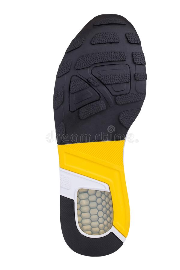 Sole of sport tracking shoes snickers individual design close up isolated one. Stylish and bright yellow black and white pattern stock photos