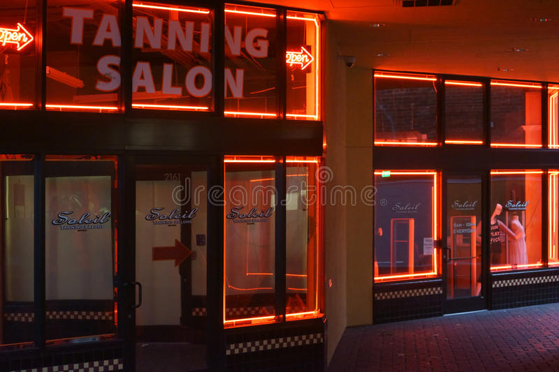 Soleil Tanning Salon Berkeley. Berkeley, United States - December 21, 2015: The neon tubes of the Soleil Tanning Salon, a sun studio on December 21, 2015 in stock images