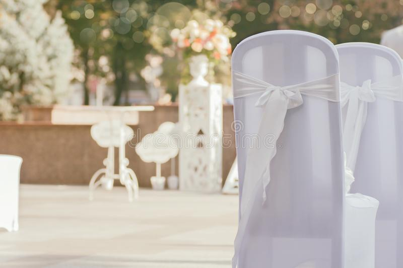 Chairs for wedding ceremony. Solemn interior, chairs decorated with bows stock photos