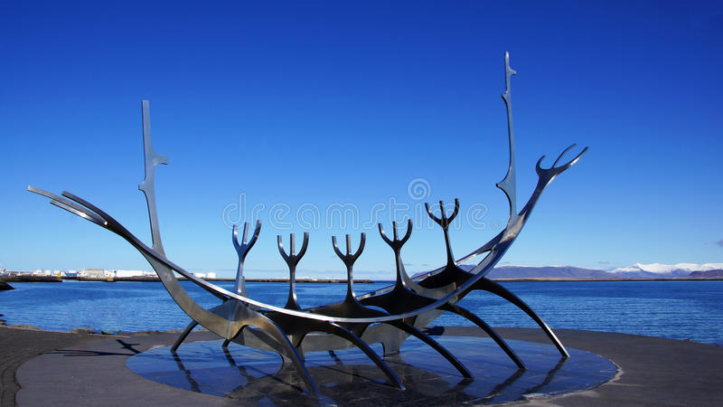 Solfar, Sun voyager sculpter in Reykjavik in Iceland. In spring with mountains of snaefelsnes in background royalty free stock images