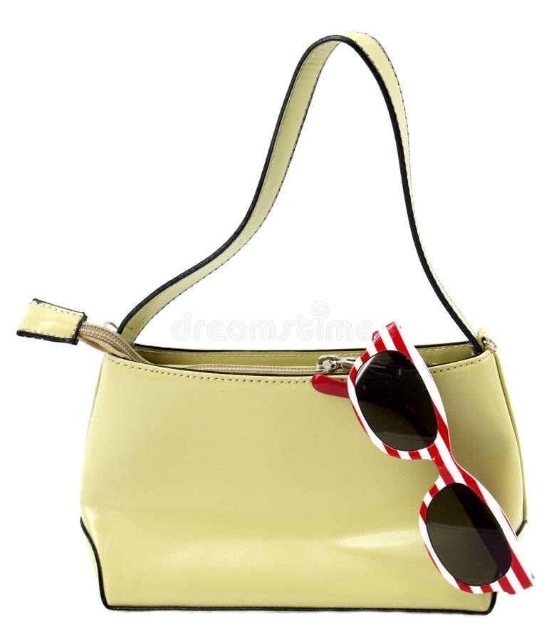 Solglasögon och handväska royaltyfria foton