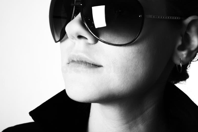 solglasögonkvinna royaltyfri bild