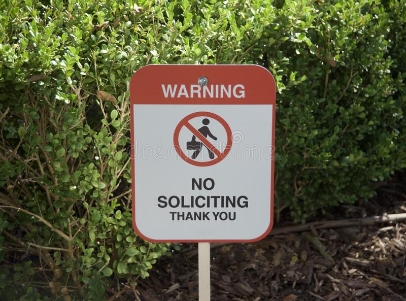 Soliciting Prohibited. Solicitation is the act of offering, or attempting to purchase, goods or services royalty free stock photo