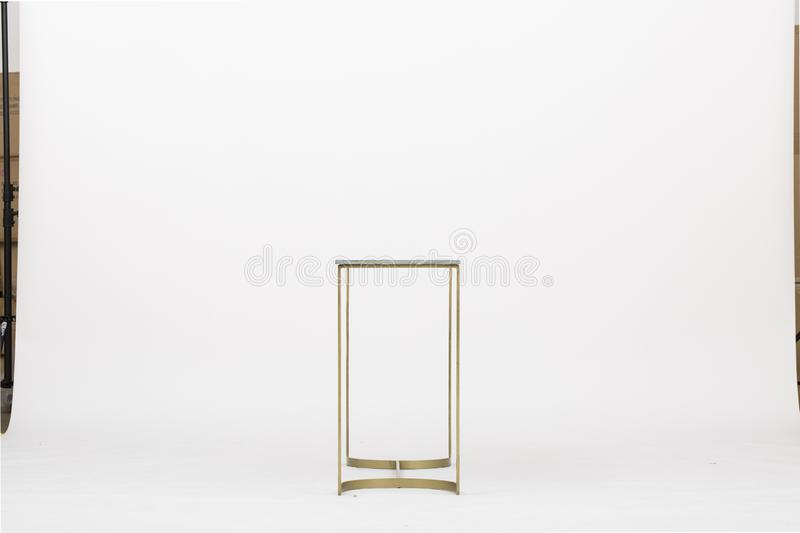 Solid Brass Tapered Leg Beveled Glass, end table side tables small regency gold leaf white top cover with white background - Image stock photo