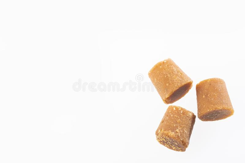Solid Cane sugar concentrate - Saccharum officinarum. Panela or sugar cane candy - Saccharum officinarum stock photo