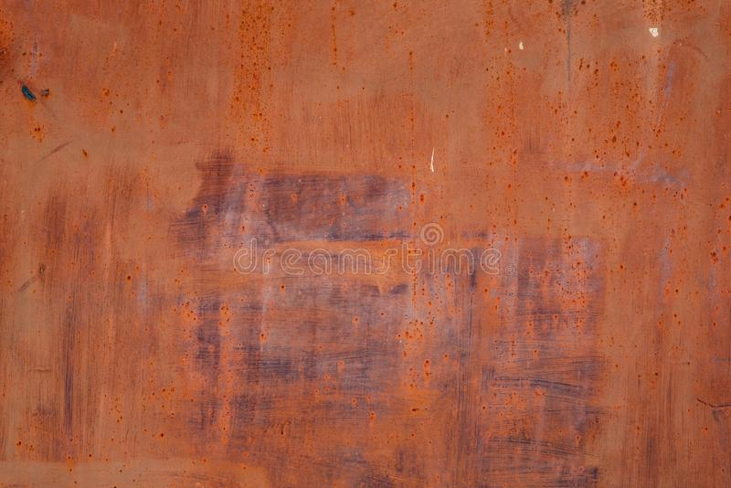 Solid color red abstract painting on metal surface. Solid color red abstract painting on rusty distressed metal surface with vertical and horizontal straight royalty free stock photos