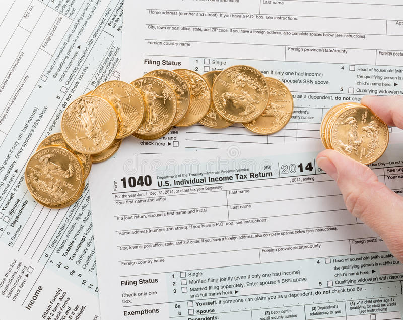 Solid Gold Coins On 2014 Form 1040 Editorial Stock Photo Image Of