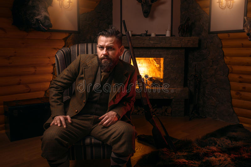 Solid male hunter in traditional hunting clothes stock photos