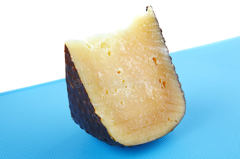 Solid Parmesan On Blue Stock Images