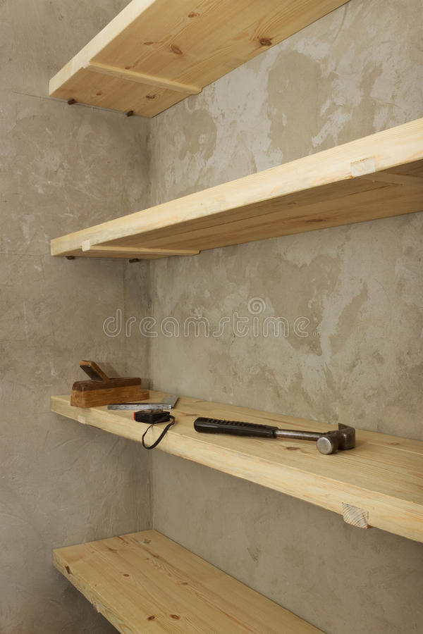 Solid shelves made of wood in rural pantry royalty free stock photo