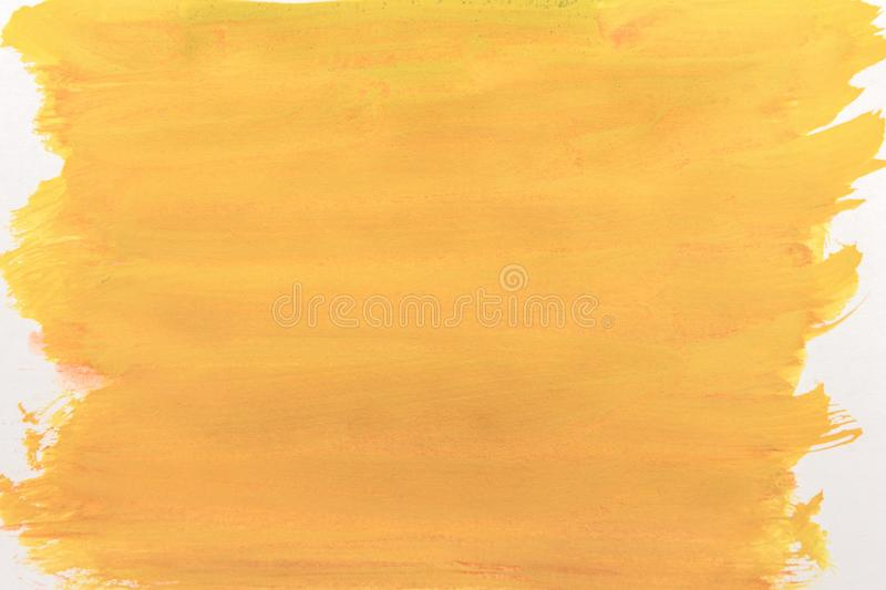 Canvas covered with bright yellow paint. abstraction. Solid vivid yellow background painted with paint and brush on canvas. backdrop for design and text royalty free stock images