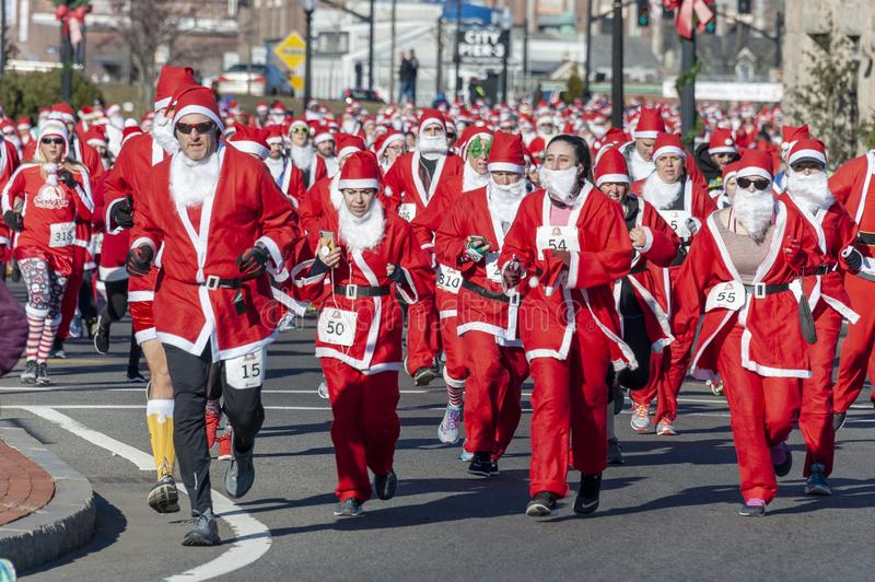Solid wall of Santas. New Bedford, Massachusetts, USA - December 8, 2018: Santas for as far as the eye can see near the start of the Santa Sightings 5K Fun Run royalty free stock images