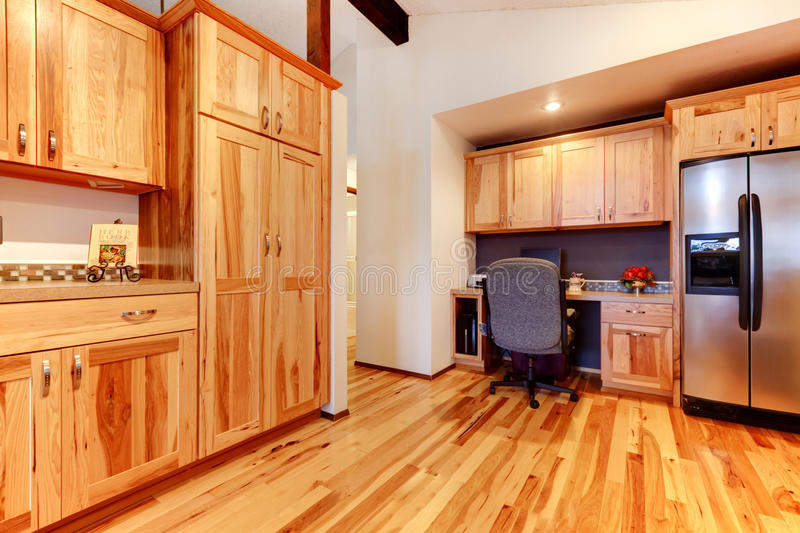 Solid wood birch kitchen custom made cabinets with hardwood floor. stock images