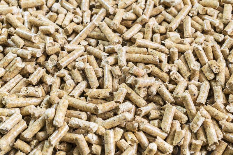 Solid Wood Pellets for stove closeup. Pressed Pellet made of Wood. royalty free stock image