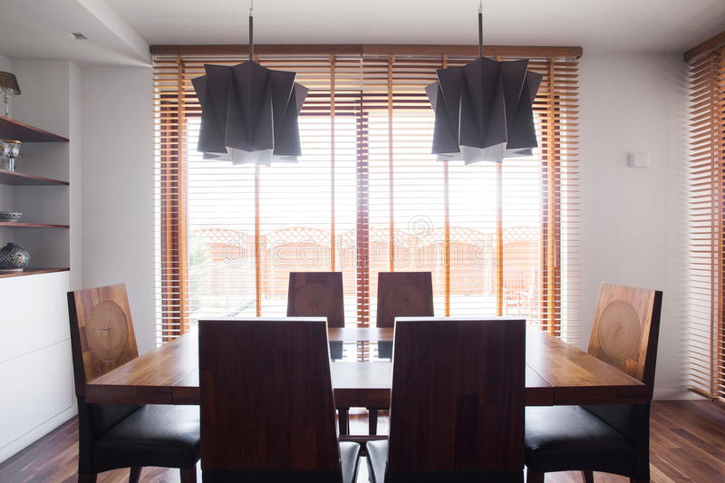 Solid wooden dining table. Image of solid simple design wooden dining table and chairs stock photography