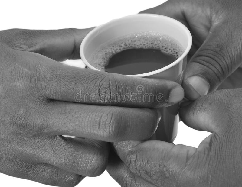 SOLIDARITY AROUND A COFFEE POT stock images