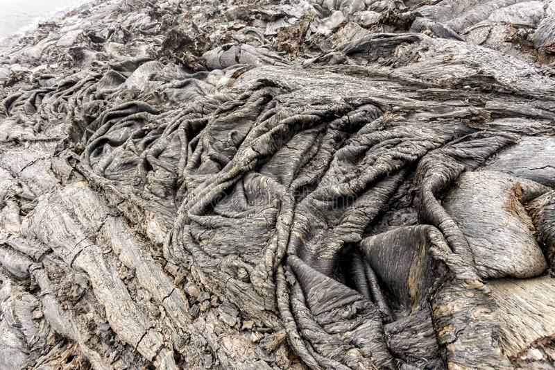 Solidified lava after volcanic eruption. Solid lava flow near Volcano Tolbachik, Kamchatka Peninsula, Russia.  stock photos