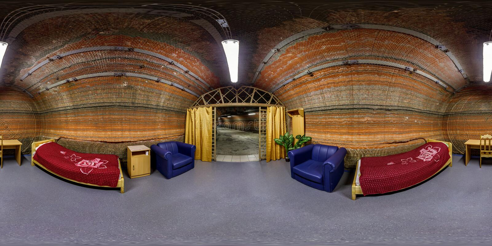 SOLIGORSK, BELARUS - MARCH, 2014: Full seamless spherical 360 degrees angle panorama interior of bedroom in speleo clinic caves of. Potassium salt in royalty free stock photography