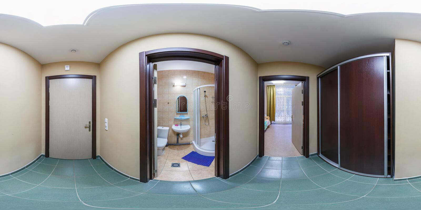 SOLIGORSK, BELARUS - SEPTEMBER, 2013: full seamless spherical panorama 360 degrees in corridor rooms of small hotel with view of. Bedroom and bathroom in royalty free stock photography