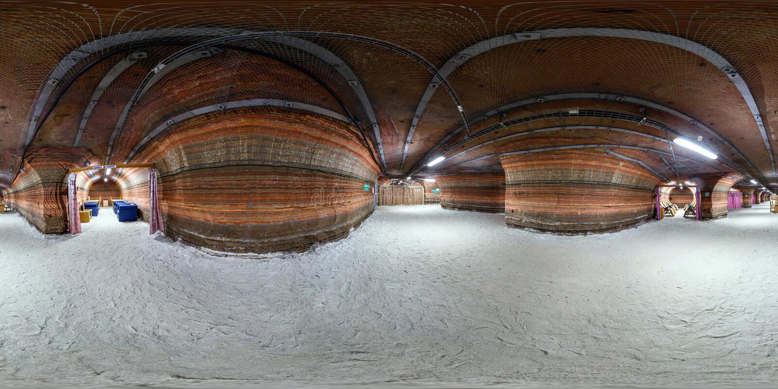 SOLIGORSK , BELARUS - SEPTEMBER 15, 2013: Interior in hospital caving in the cave of the potassium salt, full 360 degree panorama. In equirectangular spherical royalty free stock image