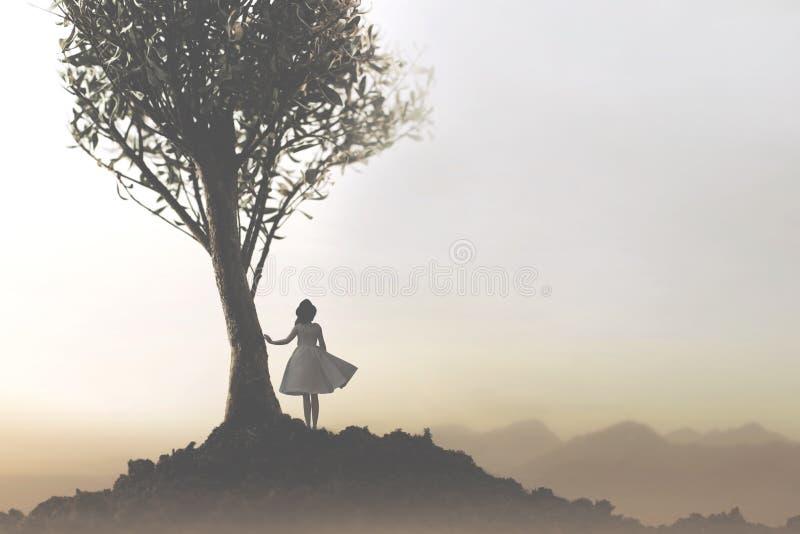 Solitaire vrouw onder een boom die een mystiek en suggestief landschap bekijken stock fotografie