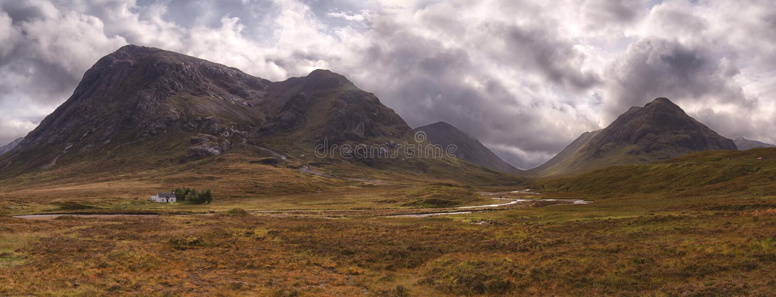 Panorama, grey clouds gather over Buachaille Etive Mor, Altnafeadh, Glencoe, Scotland. stock images