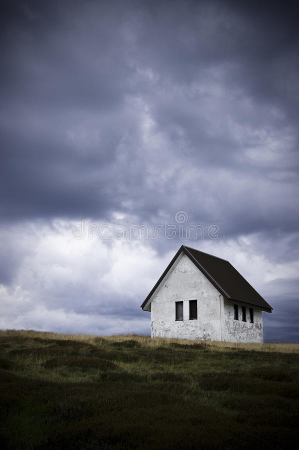 Solitary abandoned house on a hill side royalty free stock image
