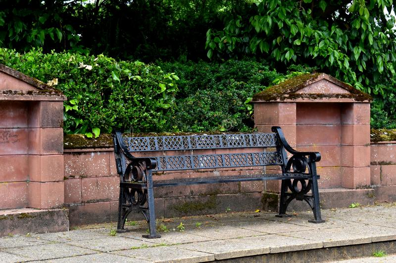Solitary Black Metal Bench royalty free stock images