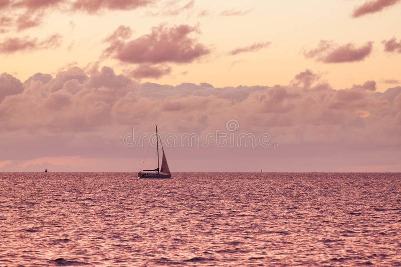 A solitary sailboat in the open sea