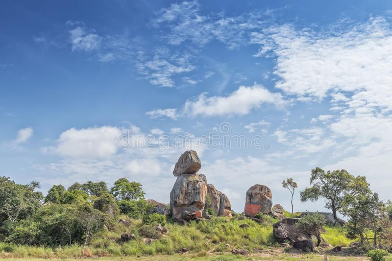 Solitary stones inserted in the African vegetation on the way to northern Angola. Soyo. Africa stock photo
