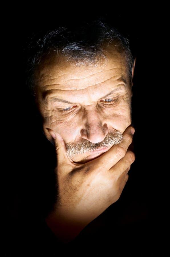 Solitudine dell'uomo anziano fotografia stock