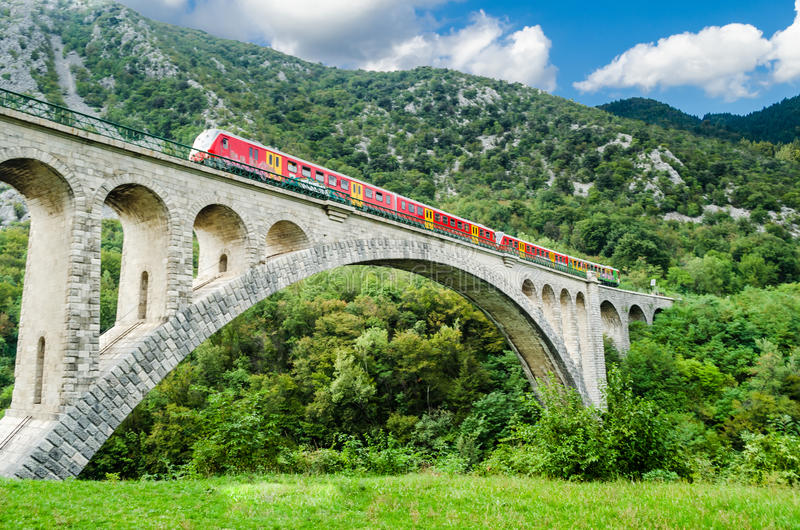 Solkan Bridge, Slovenia. With train passing stock images