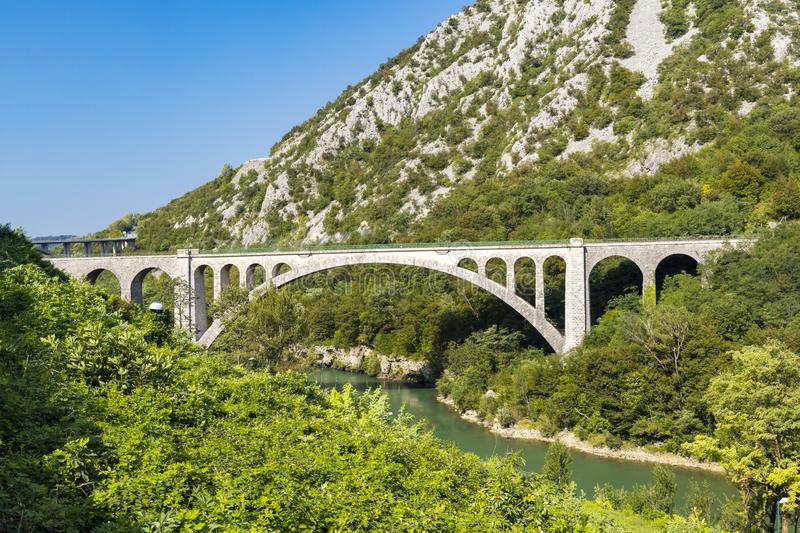 Solkan bridhe on the River Soca, Slovenia. Travel, old, nature, sky, europe, summer, tourism, landscape, blue, outdoor, wire, fence, nova, gorica, countryside stock images