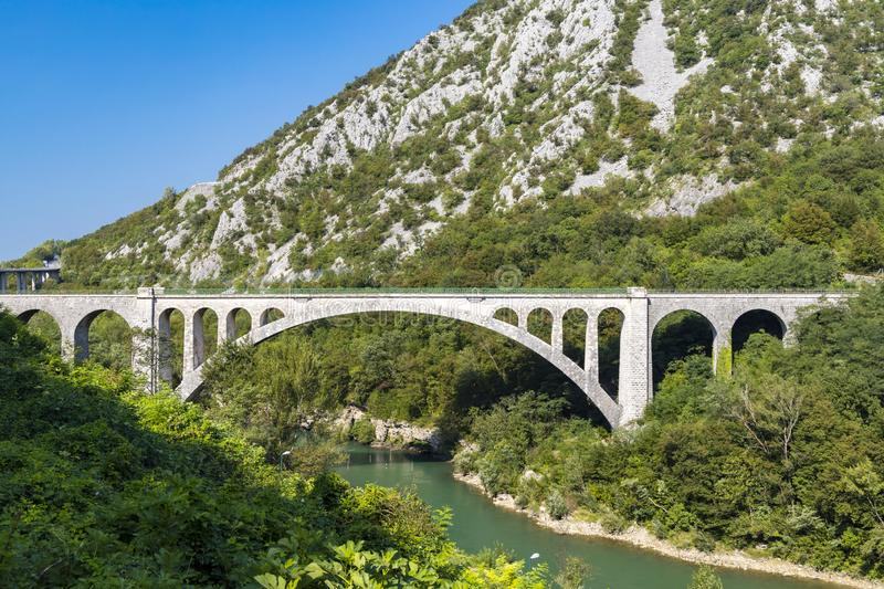 Solkan bridhe on the River Soca, Slovenia. Travel, old, nature, sky, europe, summer, tourism, landscape, blue, outdoor, wire, fence, nova, gorica, countryside royalty free stock photo