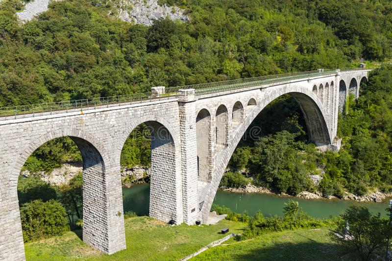 Solkan bridhe on the River Soca, Slovenia. Travel, old, nature, sky, europe, summer, tourism, landscape, blue, outdoor, wire, fence, nova, gorica, countryside royalty free stock photography