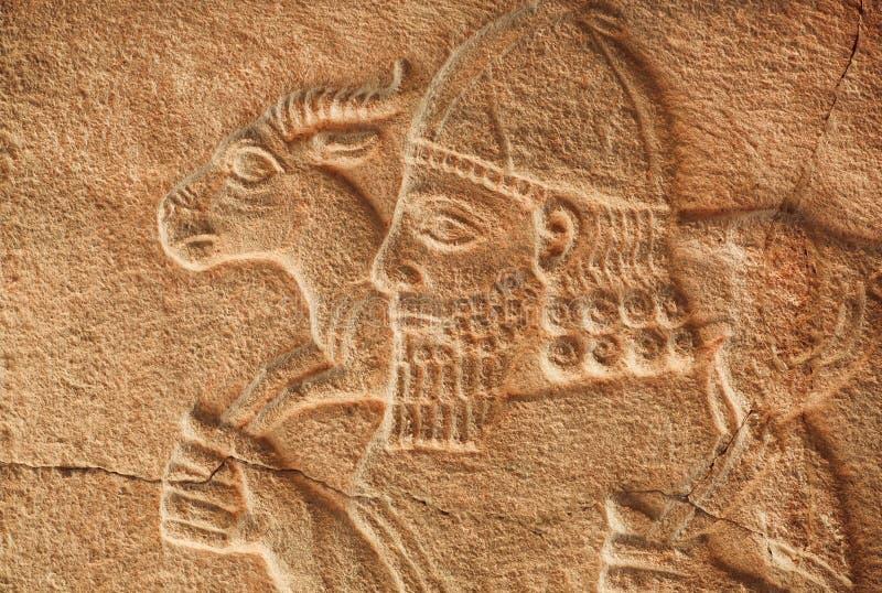 Sollievo Assyrian storico dell'agricoltore con la capra immagini stock libere da diritti